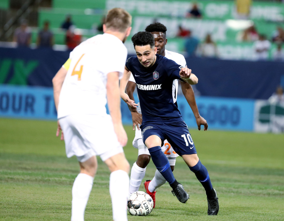 <strong>Memphis 901 FC midfielder Adam Najem (10) weaves through defenders on his way toward the goal during a match against Atlanta United 2 on Wednesday, April 10, 2019.</strong> (Houston Cofield/Daily Memphian)