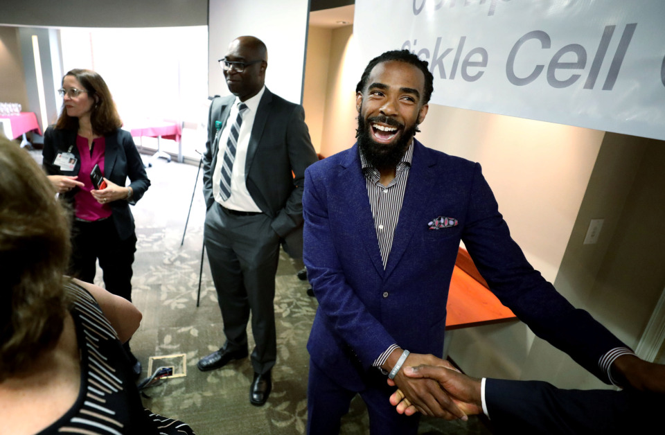<strong>Mike Conley celebrates with friends on April 11, 2019, after announcing he is donating $500,000 to Methodist Healthcare's Comprehensive Sickle Cell Center. Conley's uncle Rodney Corbin and two of his cousins have been affected by the disease.</strong> (Houston Cofield/Daily Memphian)