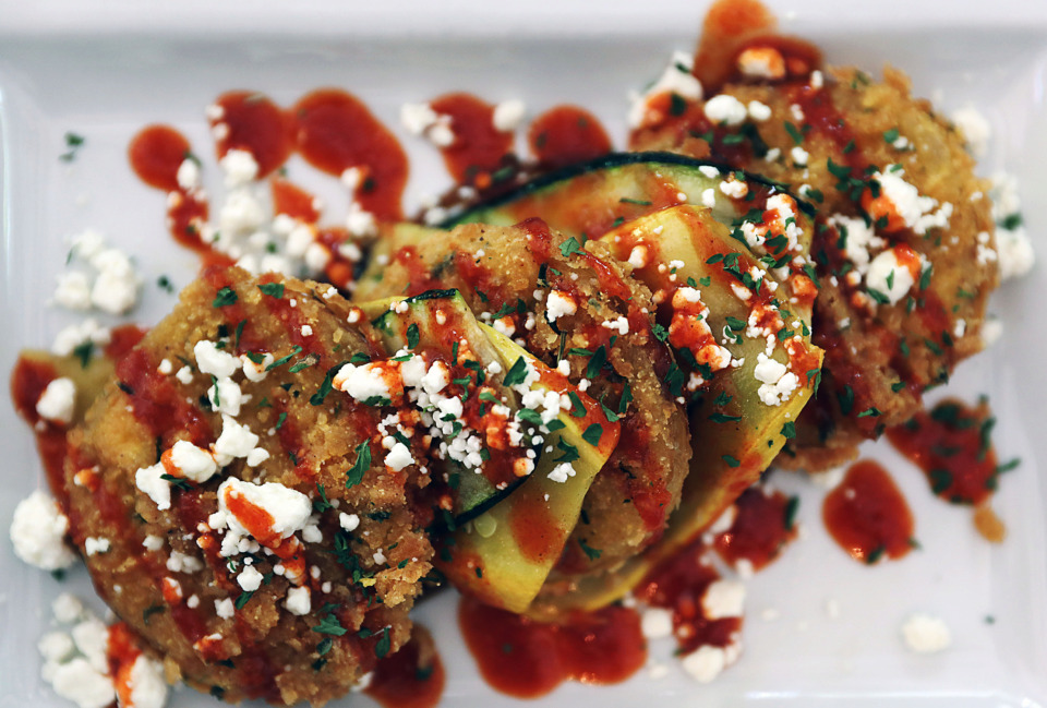 <strong>Hand-battered fried green tomato and kimchi salad with zucchini and squash tapenade and kimchi sauce.</strong> (Patrick Lantrip/Daily Memphian)