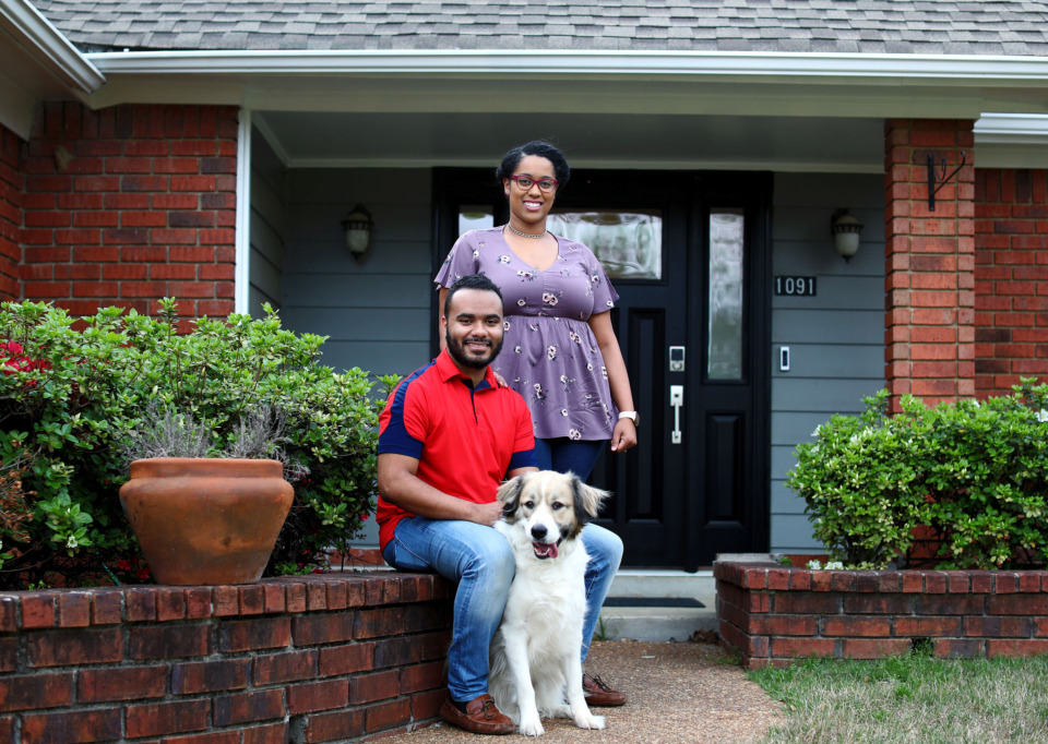 <strong>Blake Nelson (left) and Rebecca Buckley stand in front of their new Cordova home with their 2-year-old dog, Sammy. The couple purchased their mortgage through the Pinnacle 100 program provided by Pinnacle Financial Partners that requires no down payment.</strong> (Houston Cofield/Daily Memphian)