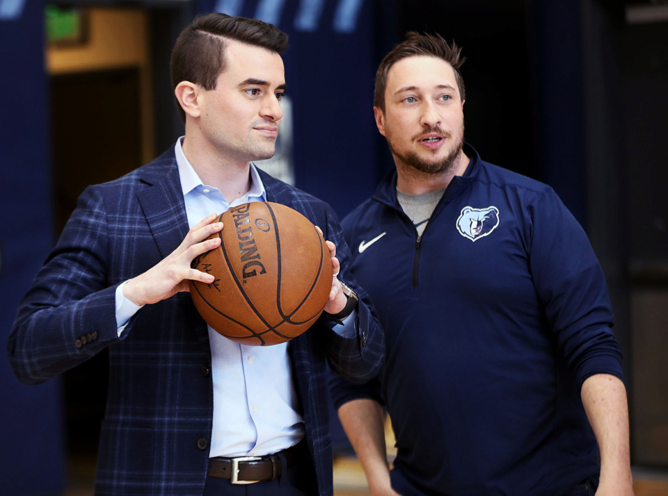 <strong>Zachary Kleiman (left), the Memphis Grizzlies' new executive vice president of basketball operations, talks to communications and publications manager Ross Wooden before a media event Friday, April 12, 2019.</strong> (Patrick Lantrip/Daily Memphian)