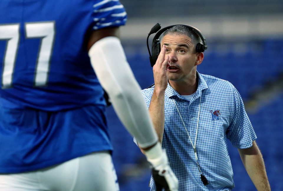 <strong>University of Memphis football coach Mike Norvell talks with one of his players during the annual Friday Night Stripes scrimmage on April 12, 2019. Norvell is going into his fourth season as the Tigers' head coach.</strong>&nbsp;(Houston Cofield/Daily Memphian)
