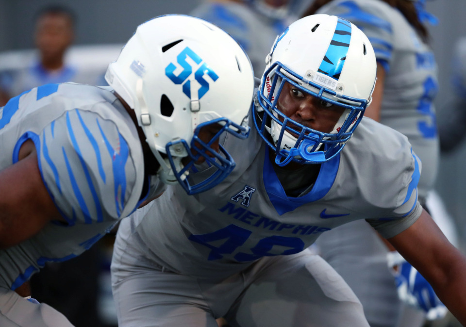 <strong>University of Memphis defensive lineman Wardalis Ducksworth (55) practices defensive drills prior to the annual Friday Night Stripes scrimmage game on April 12, 2019.</strong> (Houston Cofield/Daily Memphian)