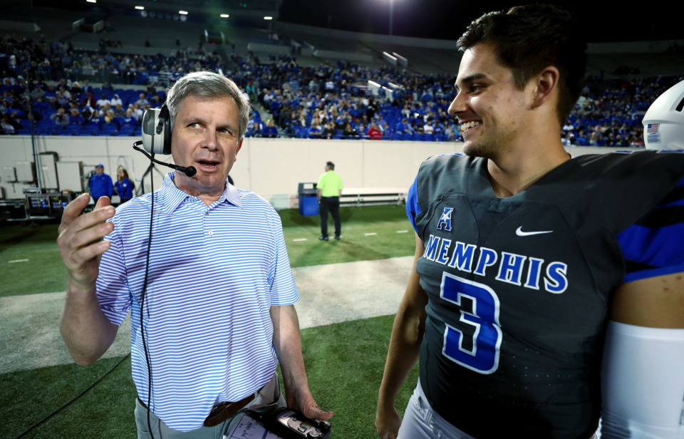 <strong>Daily Memphian columnist Geoff Calkins discusses offensive plays with University of Memphis quarterback Brady White (3) during the annual Friday Night Stripes scrimmage on April 12, 2019. Calkins was among a select group of guest coaches who were invited to call plays for a quarter of the game.</strong> (Houston Cofield/Daily Memphian)