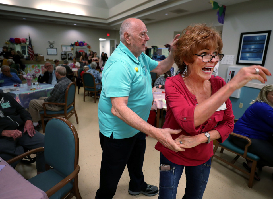 <strong>Jim S. (left) and Toni Rhylander swing dance to live music at the 10th annual senior prom hosted by Page Robbins Adult Day Center. The center encourages patients with Alzheimer's disease and dementia to attend to promote creating new memories.</strong> (Houston Cofield/Daily Memphian)