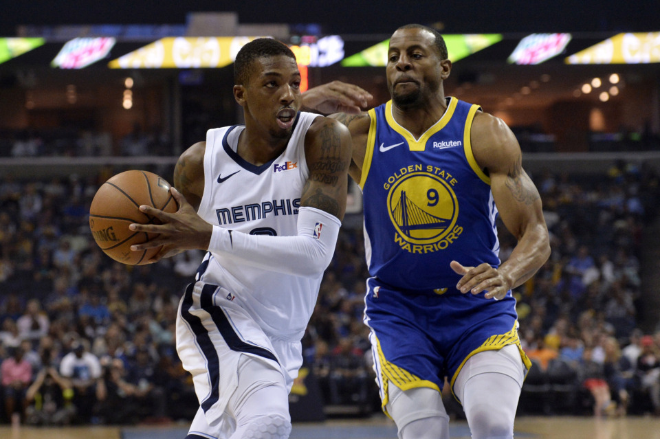 <strong>Memphis Grizzlies guard Delon Wright drives against Golden State Warriors guard Andre Iguodala on Wednesday, April 10, in Memphis. Wright had three triple-doubles in the Grizzlies&rsquo; last four games of the season, including 13 points, 11 rebounds and 11 assists against the Warriors.</strong>&nbsp;(Brandon Dill/Associated Press)