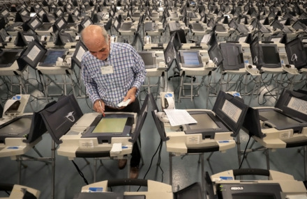 <strong>Volunteer Rick Riedell works on getting voting machines ready Oct. 16, 2018, at the Shelby County Election Commission Operations Center. The state House passed legislation Monday penalizing voter registration drives that produce large numbers of &ldquo;incomplete&rdquo; forms.</strong> (Jim Weber/Daily Memphian)