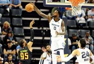 Grizzlies forward JaMychal Green blocks a shot by by Atlanta Hawks' DeAndre Bembry. The Grizzlies beat the Hawks 110-120 in the first pre-season game of the year. (Houston Cofield/Daily Memphian)