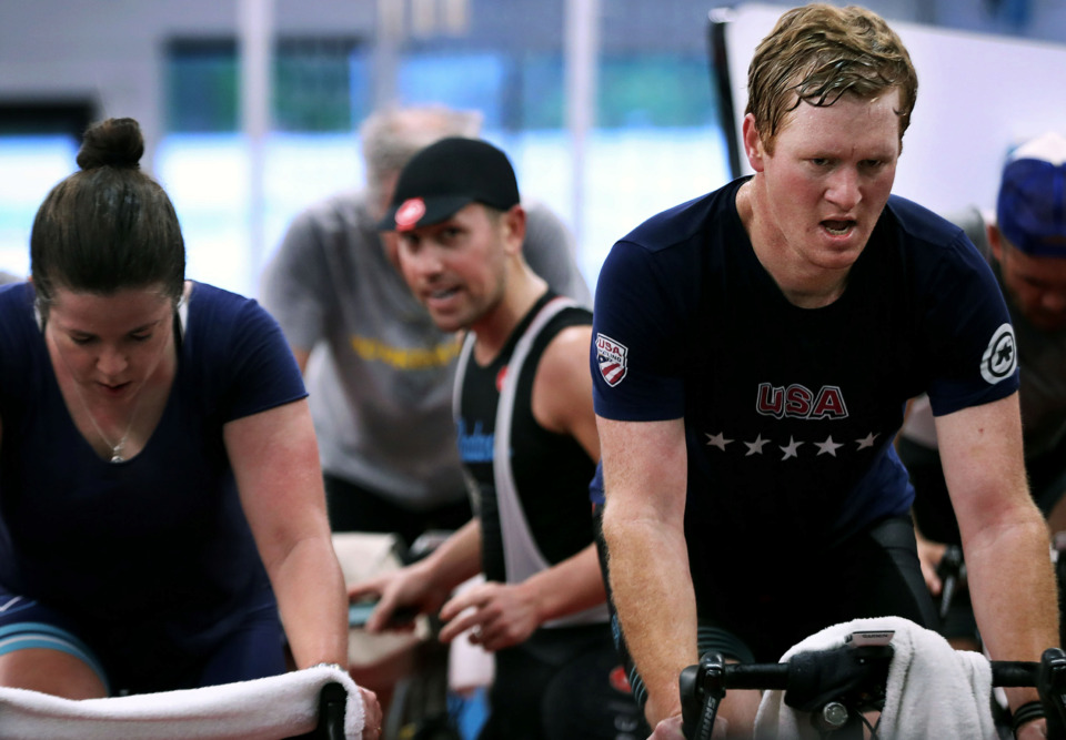 <strong>Judson Williford (right) trains with Victory Bicycle Studio owner Clark Butcher (center) Friday, April 12. Williford is training for the third Lucy 115, a 115-mile trek from Nashville to Sewanee University in honor of his daughter, Lucy, who passed away unexpectedly in 2017. Proceeds from the ride benefit Le Bonheur Children's Hospital.</strong> (Patrick Lantrip/Daily Memphian)