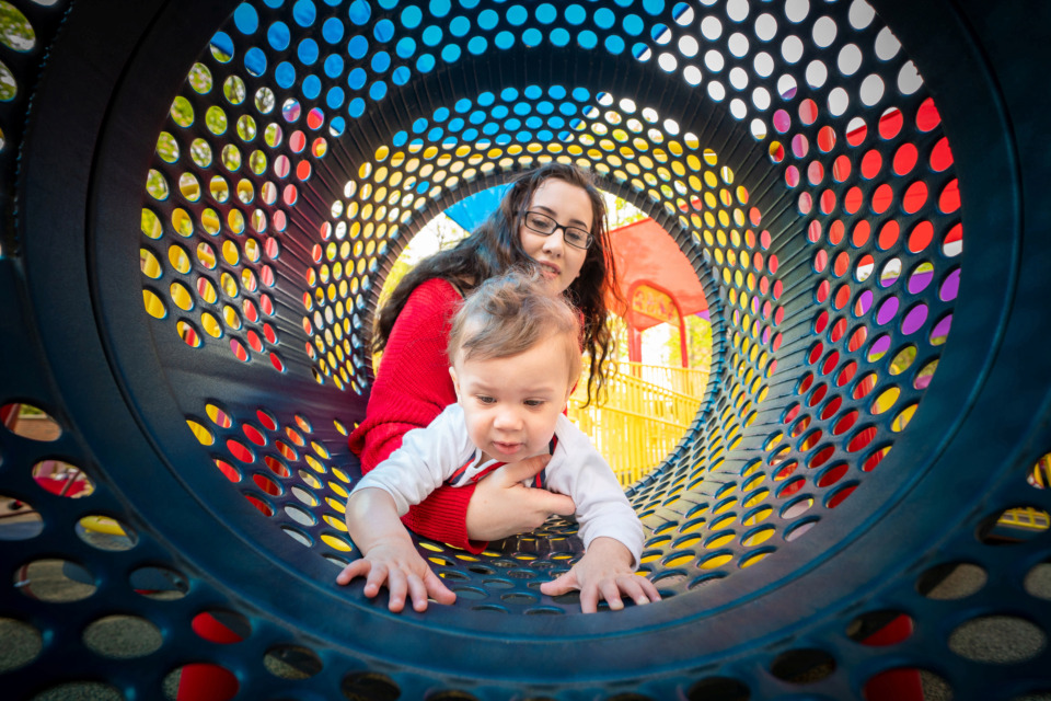 <strong>St. Jude patient Omarion Jordan plays outside with his mother, Kristin Simpson, on Wednesday, April 17, 2019, without the protective clothing he previously had to wear whenever he left isolation. Researchers at St. Jude Children&rsquo;s Research Hospital have developed a novel treatment using HIV as a vector to deliver re-engineered blood cells that create an immune system for patients like 1-year-old Omarion who are born without one.</strong>&nbsp;(Courtesy of St. Jude)