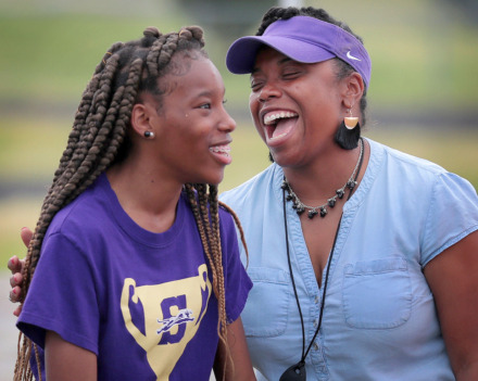 "<strong>Southwind coach Alisa Seymour (right) jokes with standout sprinter Breanna Miles during a workout at Southwind High on April 17, 2019. ""Breanna's a leader,"" Seymour says. ""She motivates the girls, makes sure they're warming up properly, and she practices hard every single day.""</strong> (Jim Weber/Daily Memphian)"