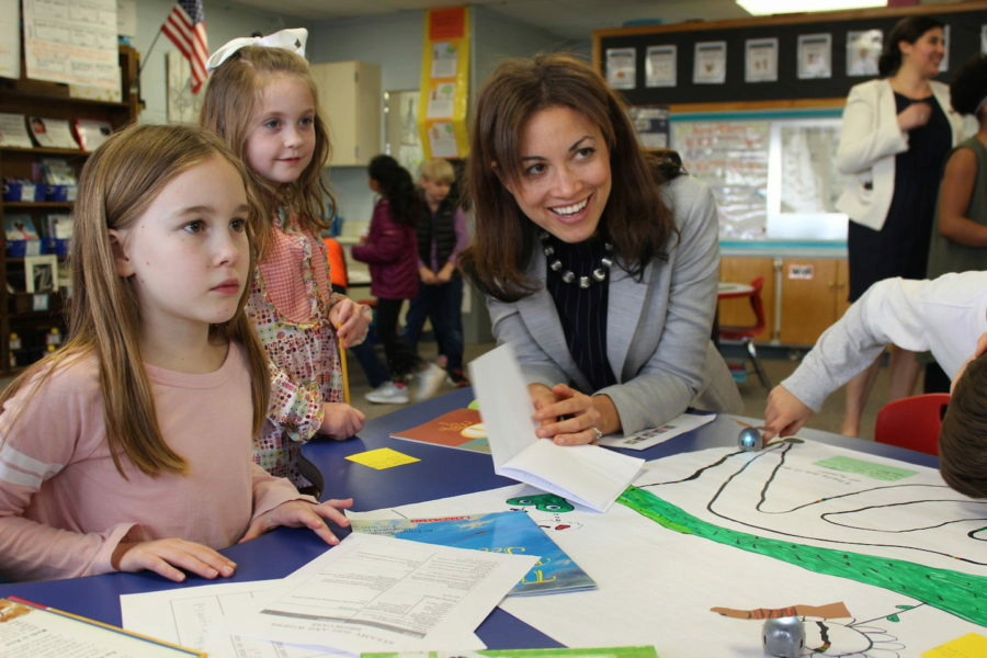 """<div class=""""featured-image article-img""""><div class=""""wp-caption-text""""><strong>Penny Schwinn visits with students at a school in Rutherford County in February, soon after becoming education commissioner in Tennessee.</strong> (Courtesy of Tennessee Department of Education)</div></div>"""