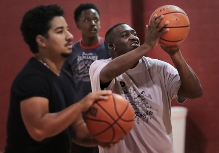 "<strong>Eric ""Cowboy"" Robinson (right) shoots baskets with his team, the Midsouth Sports Academy, at the Faith Community AME Church gym in Southaven in September 2018. </strong>&nbsp;(Jim Weber/Daily Memphian file)"