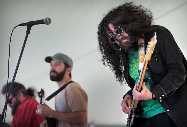 "<strong>Bass player Andrew Gerazi (right) performs with Tony Manard and Show Goat during the first Mid-South Hemp Fest at Overton Park on April 20, 2019. With over 100 booths selling or promoting cannabis and hemp products, marijuana advocates gathered to listen to live music and enjoy a food truck rodeo in observance of 4/20, the counterculture holiday derived from ""420"" - insider shorthand for cannabis consumption.</strong> (Jim Weber/Daily Memphian)"