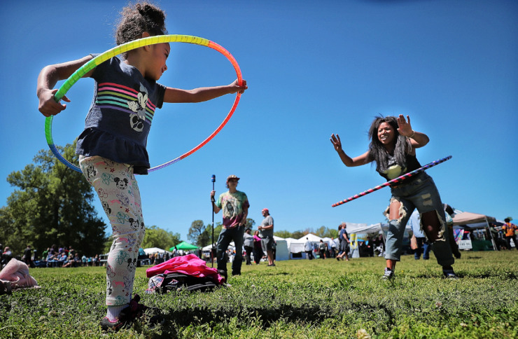 <strong>Ava Butterick, 4, takes a hula hoop lesson from her mother, Jessica Stevenson (right), during the first Mid-South Hemp Fest on April 20, 2019, at Overton Park.</strong> (Jim Weber/Daily Memphian)