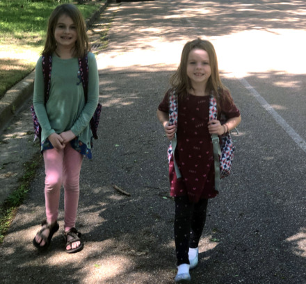 <span><strong>Allison LaRue walks daughters Corinne (left) and Meryl to Riverdale Elementary School each day. Much of their trek doesn't have sidewalks. The Germantown Board of Mayor and Aldermen will consider a contract to add sidewalks when school ends for the year.</strong> (Photo courtesy of&nbsp;Allison LaRue)</span>
