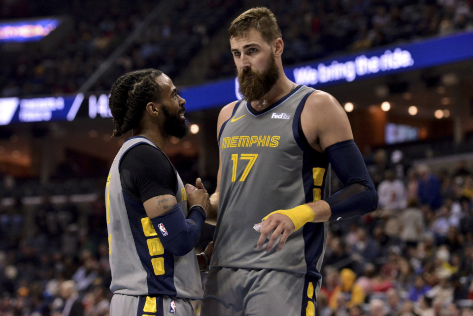 <span><strong>Memphis Grizzlies guard Mike Conley, left, and center Jonas Valanciunas (17) talk on the court between plays in the second half of an NBA basketball game against the Houston Rockets Wednesday, March 20, 2019, in Memphis, Tenn.</strong> (AP Photo/Brandon Dill)</span>