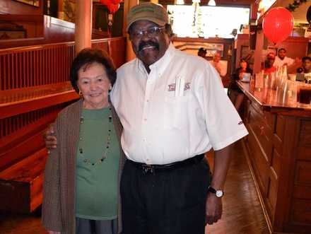 <strong>Jack Dyson, a waiter at the Rendezvous for 48 years, poses with Vergos matriarch Anastasia Vergos at Dyson's 2013 retirement party.</strong> (Courtesy of the Vergos family)