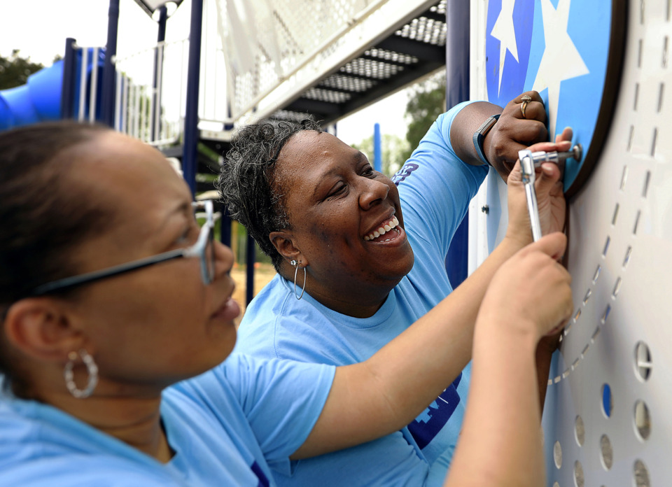 <strong>Volunteers Janice Hubbard (right) and Damita Townsend share a laugh while building a new playground at David Carnes Park in Whitehaven Tuesday, April 23, 2019. The $5.4 million renovation is the first project under the BlueCross BlueShield of Tennessee Health Foundation's BlueCross Healthy Place program.</strong> (Patrick Lantrip/Daily Memphian)