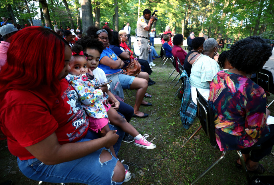 "<strong>Kytrenna Starnes (left) sits with her daughters Morgan Arnold (center), 2, and Alaya Brown (right), 9, as they remember loved ones who were lost during the 14th annual Garden of Lights event at the Memphis Botanic Gardens on Tuesday, Apr. 23, 2019. The F.F.U.N ""Stop The Killing"" group, headed by Stevie Moore, organized the event in collaboration with the Shelby County Crime Victims &amp; Rape Crisis Center.</strong> (Houston Cofield/Daily Memphian)"