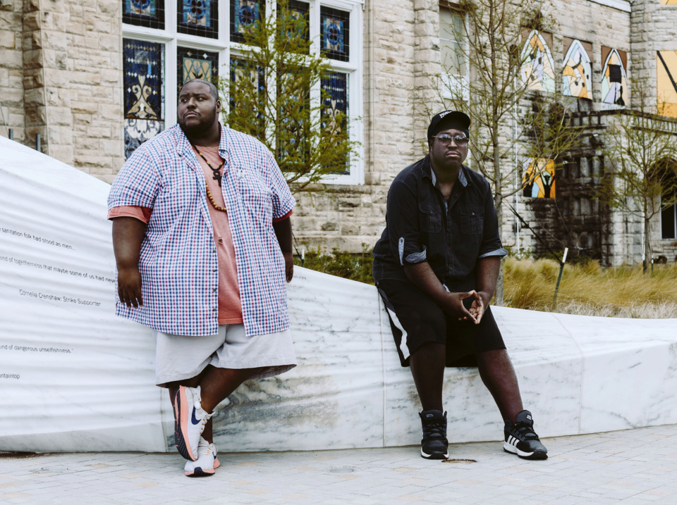 <strong>Joseph Higgins (left) sits with his brother David Higgins (right) outside of Clayborn Temple where they have planned to have the funeral service for their late brother Omar Higgins. Higgins was best known for his influence in the Memphis music scene as the lead for the band Negro Terror and Chinese Connection Dub Embassy.</strong> (Houston Cofield/Daily Memphian)