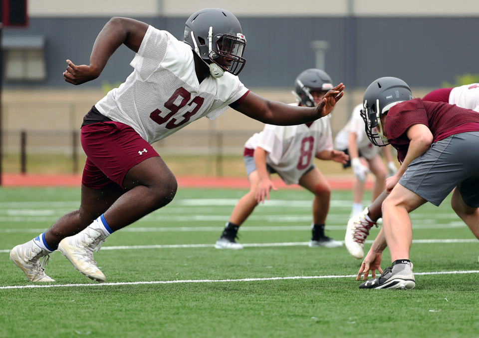 <strong>Collierville standout defensive end Jared Dawson hones his pass rushing skills during a Thursday, April 25, 2019, practice at Collierville High.</strong> (Patrick Lantrip/Daily Memphian)