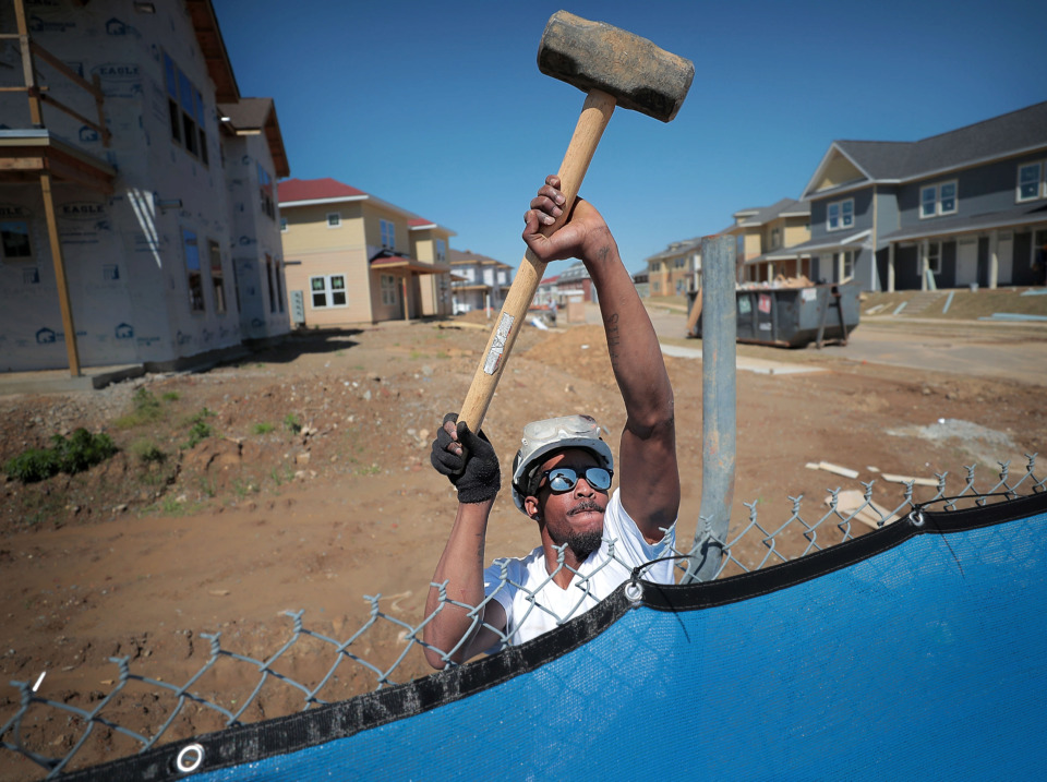 <strong>Arrhenius Eggleston anchors a security fence surrounding the first phase of the new mixed-use South City neighborhood south of FedExForum.</strong> (Jim Weber/Daily Memphian)