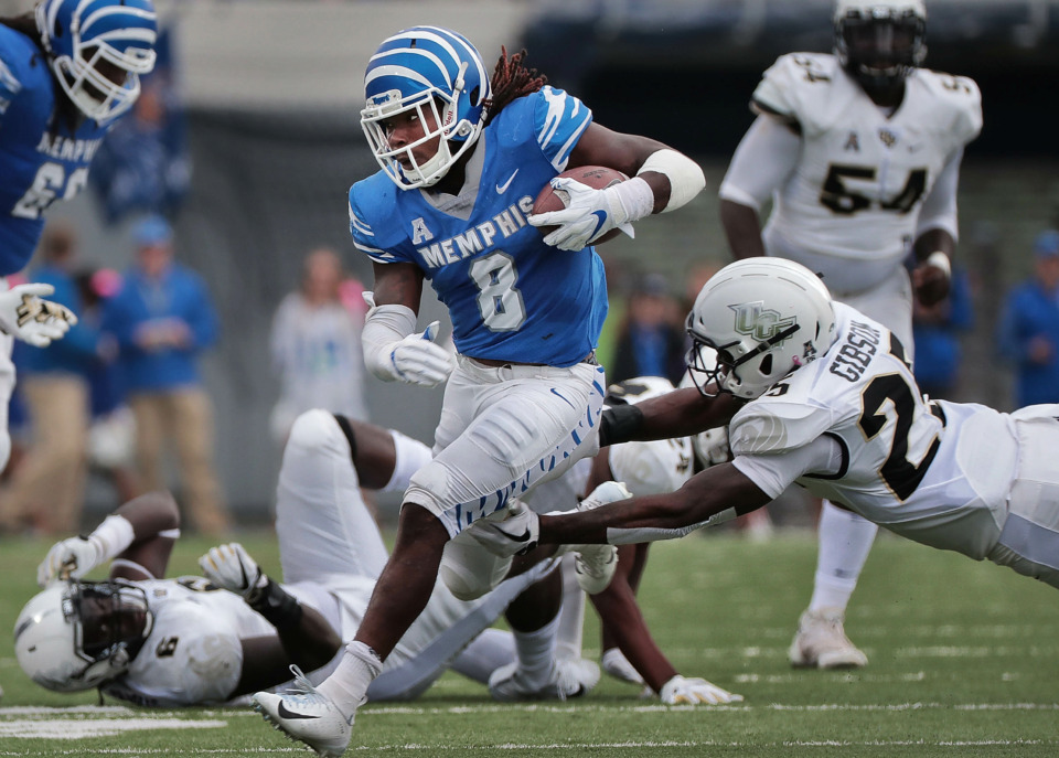 <strong>University of Memphis running back Darrell Henderson (8) breaks a tackle on a run as the Tigers play UCF at Liberty Bowl Memorial Stadium on Oct. 13, 2018. The Los Angeles Rams selected Henderson with the No. 70 pick in the third round of the NFL Draft.</strong> (Jim Weber/Daily Memphian file)