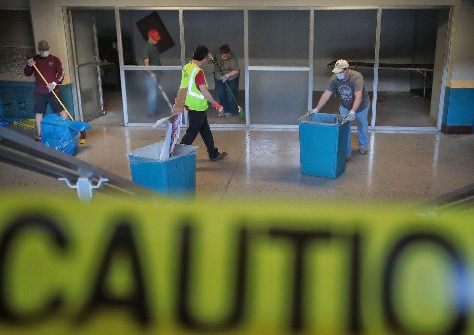 <strong>Volunteers pitch in Saturday, April 27, 2019, to remove debris and clean the Mid-South Coliseum. The Coliseum Coalition and Clean Memphis invited members of the public to assist with the effort.</strong>&nbsp;(Jim Weber/Daily Memphian)