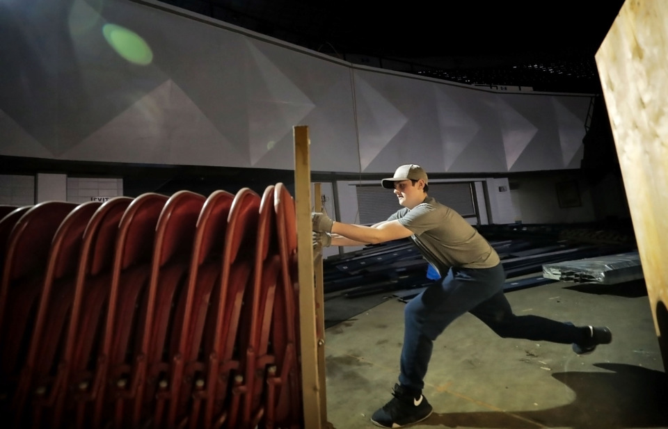 <strong>Brian George shifts a rack of folding chairs at the Mid-South Coliseum on Saturday, April 27, 2019. The volunteer effort, aimed at cleaning up the arena, was arranged by Coliseum Coalition and Clean Memphis.</strong> (Jim Weber/Daily Memphian)