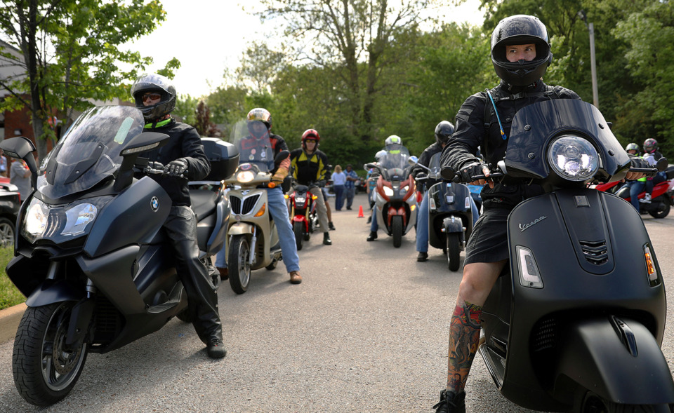 <strong>Tim Adair (right) leads the first ride out for a scooter rally Saturday, April 27, 2019, celebrating the first anniversary of the My City Rides Program. About 150 bikers were expected to gather in front of the My City Rides shop at 376 N. Cleveland.</strong>&nbsp;(Patrick Lantrip/Daily Memphian.)