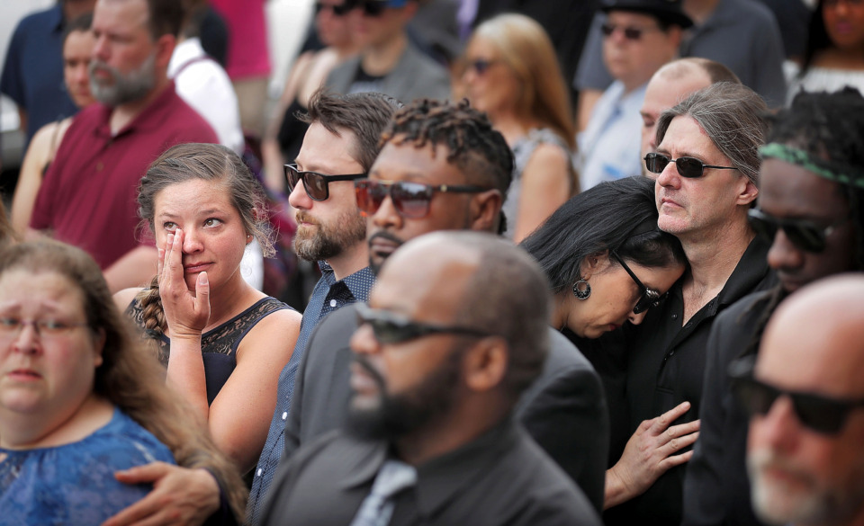 <strong>Tiffany Canerday (left) and Sandy Ellison (right) react as the casket of Memphis musician Omar Higgins is carried into Clayborn Temple for a visitation and funeral service on Tuesday, April 30, 1019.</strong> (Jim Weber/Daily Memphian)
