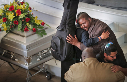 <strong>Joseph Higgins (right) welcomes mourners during a visitation and funeral on Tuesday, April 30, 2019, for his late brother, Omar Higgins, leader of the reggae band Chinese Connection Dub Embassy.</strong> (Jim Weber/Daily Memphian)