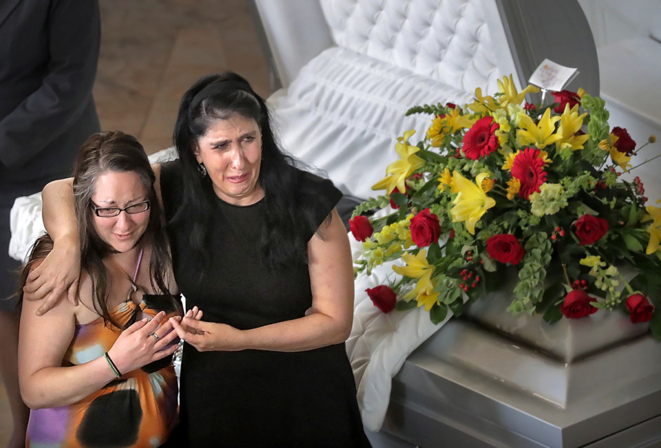 <strong>Laura Fackler (left) and Sandy Ellison embrace during a visitation for late Memphis musician Omar Higgins on April 30, 2019, at Clayborn Temple.</strong> (Jim Weber/Daily Memphian)
