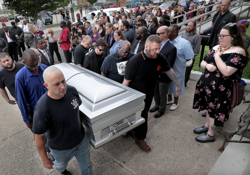 <strong>Members of Skinheads Against Racial Prejudice (SHARP) act as pallbearers for the Memphis musician Omar Higgins as mourners gather at Clayborn Temple on Tuesday, April 30, 2019, to honor the late leader of the reggae band Chinese Connection Dub Embassy. </strong> (Jim Weber/Daily Memphian)