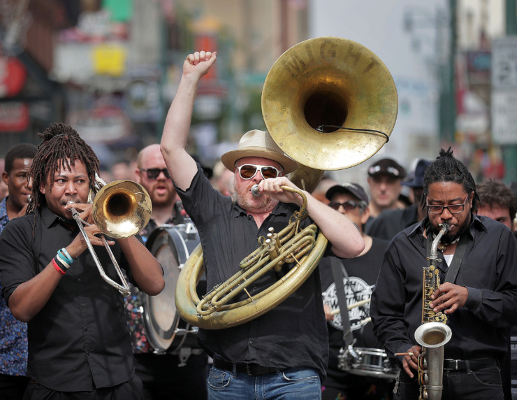 <strong>Local musicians, fans, friends and family gather for a Beale Street funeral procession to honor musician Omar Higgins, who was leader of the reggae band Chinese Connection Dub Embassy and hardcore punk band Negro Terror. </strong>(Jim Weber/Daily Memphian)