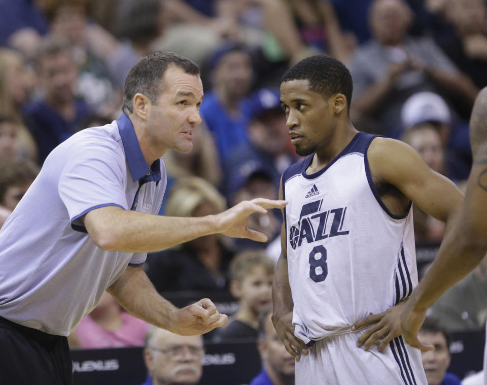 <span><strong>Utah Jazz summer league head coach Alex Jensen speaks with Utah Jazz's Bryce Cotton (8) during the second half of an NBA summer league basketball game against the San Antonio Spurs Tuesday, July 7, 2015, in Salt Lake City. The Jazz won 72-70.</strong> (AP Photo/Rick Bowmer)</span>