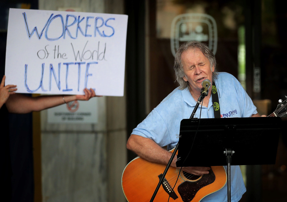 <strong>Paul Crum performs for a small crowd during a May Day Rally outside City Hall on May 1, 2019, to celebrate International Workers' Day promoted by the labor movement to honor workers and draw attention to issues like workplace inequality, the wage gap, parental leave and sexual harassment.</strong> (Jim Weber/Daily Memphian)