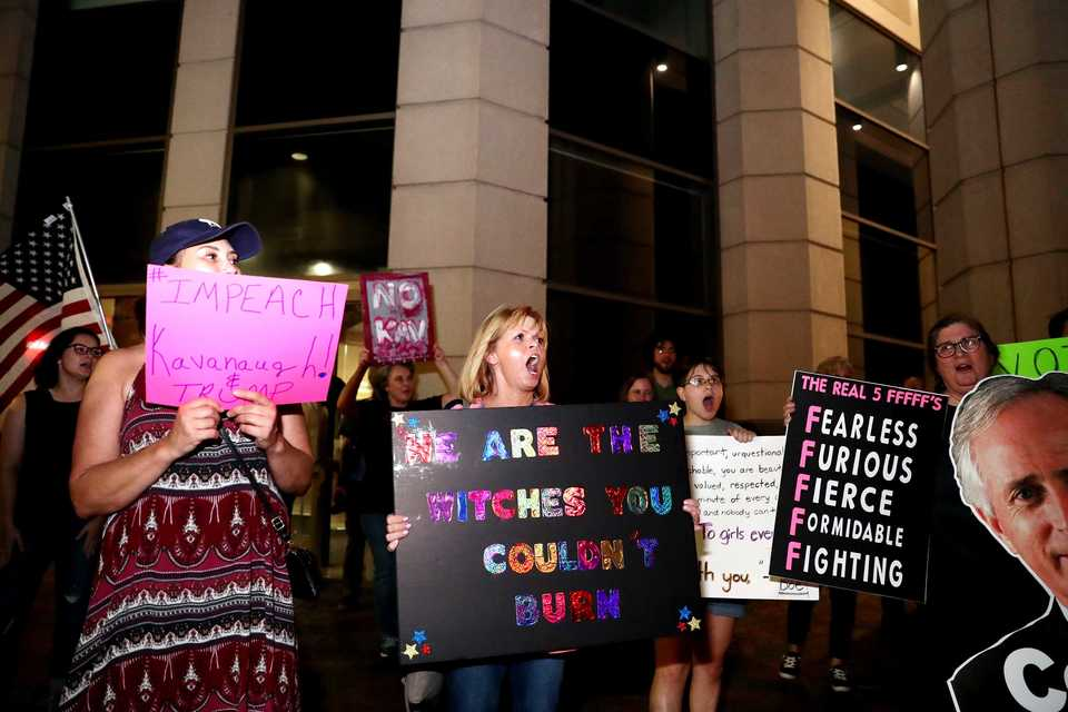 <strong>Diana Chabot (center) joins other protestors at the corner of Main Street and Peabody Place Monday to protest the confirmation of Judge Brett Kavanaugh as a U.S. Supreme Court justice.</strong> (Houston Cofield/Daily Memphian)