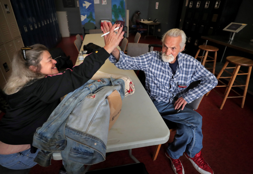 <strong>Stephen Bishop (right) gets a high-five from Tina Carter when she finds out&nbsp;on May 3, 2019, he is getting help from the Hospitality Hub to get a bus ticket to Tulsa, Oklahoma, to live with relatives. The Hospitality Hub, a centralized resource to help people escape&nbsp; homelessness, wants to use $8 million in public/private funding to expand and relocate its service to 501 Washington St., in Downtown Memphis.</strong> (Jim Weber/Daily Memphian)