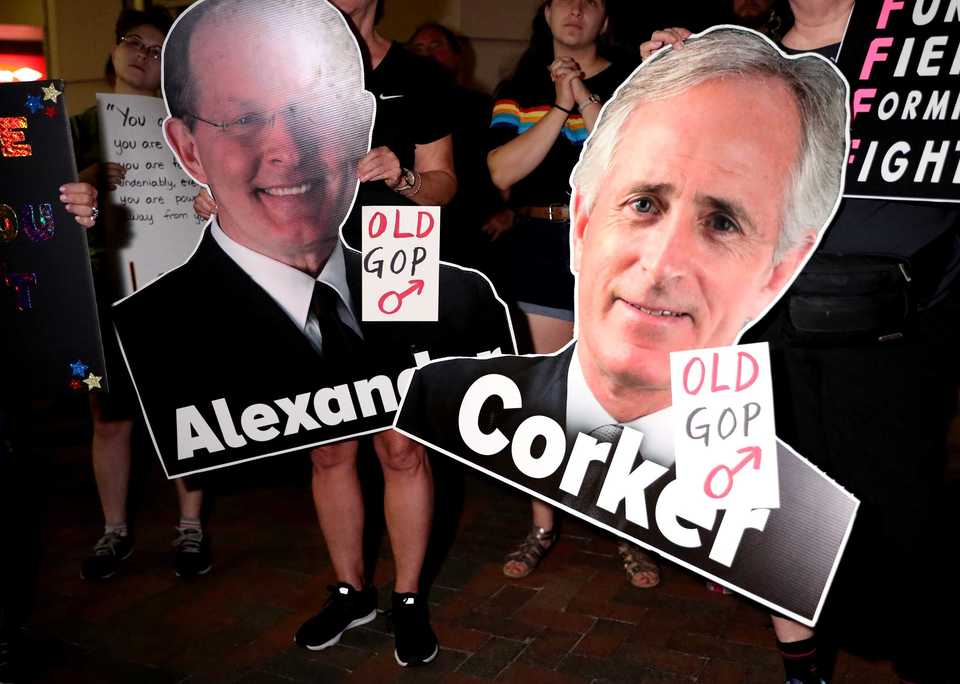 <strong>Protesters of Judge Brett Kavanaugh's confirmation to the U.S. Supreme Court hold signs depicting Sens. Lamar Alexander and Bob Corker, who were among the 50-48 majority who voted in favor of Kavanaugh.</strong> (Houston Cofield/Daily Memphian)
