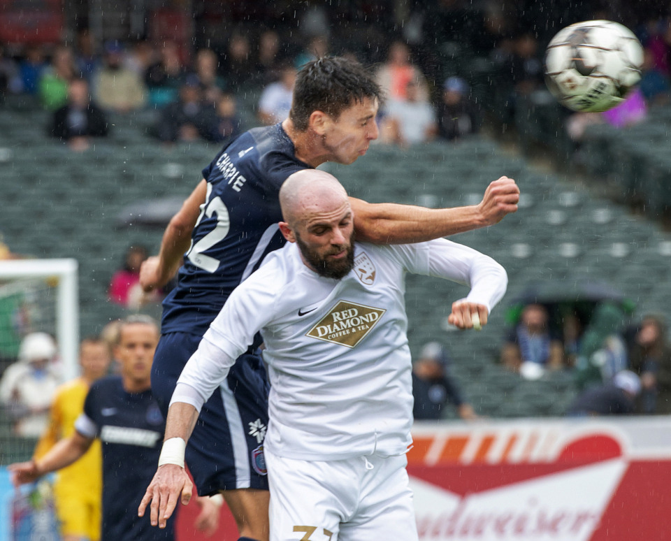 <strong>Memphis 901 FC defender Wesley Charpie leaps over Birmingham Legion defender Kyle Culbertson in a battle for control of the ball during a match Saturday, May 4, 2019, at AutoZone Park.</strong> (Greg Campbell/Special for The Daily Memphian)