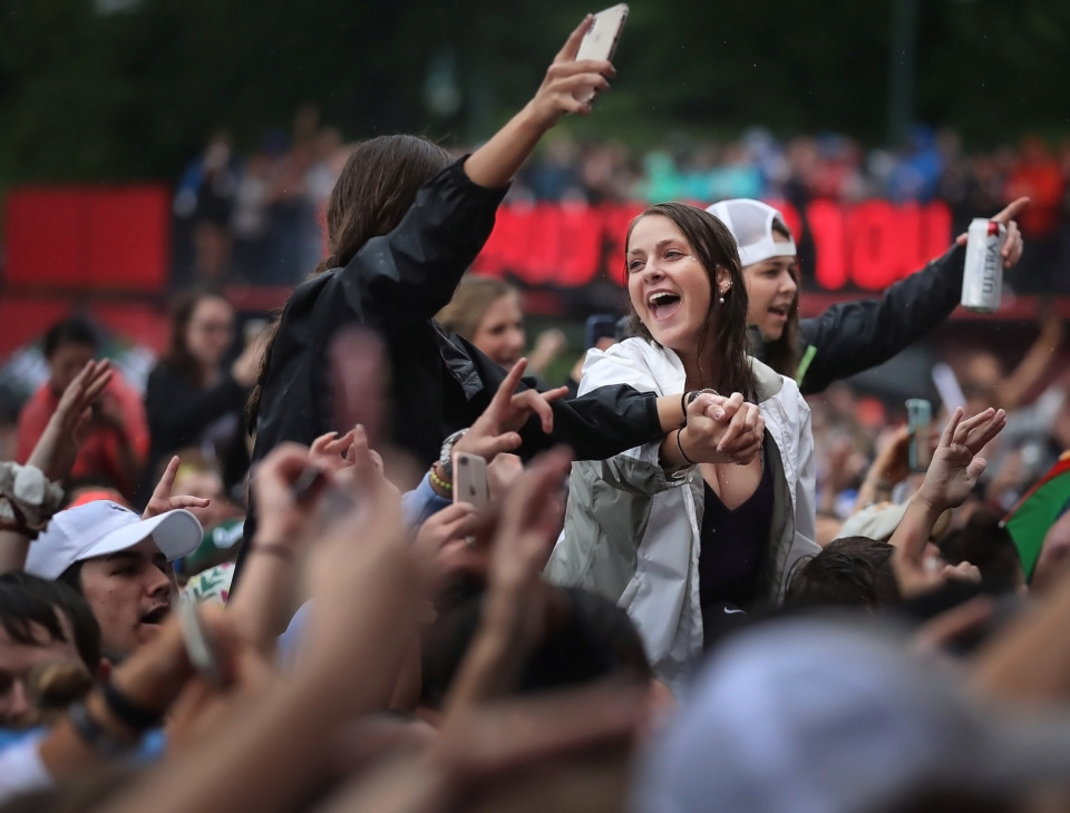 "<strong>Miley Cyrus fans sing along to ""Party In the USA"" during the 2019 Beale Street Music Festival on May 4, 2019, at Tom Lee Park. Despite a persistent drizzle, thousands of fans turned out for performances by Muck Sticky, Echosmith, OneRepublic and Blind Mississippi Morris as well as a surprise visit by Miley Cyrus.</strong> (Jim Weber/Daily Memphian)"