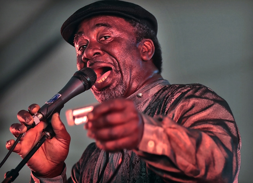 "<strong>Terry ""Harmonica"" Bean performs in the Blues Tent during the 2019 Beale Street Music Festival on May 4, 2019, at Tom Lee Park. Despite a persistent drizzle, thousands of fans turned out for performances by Muck Sticky, Echosmith, OneRepublic and Blind Mississippi Morris as well as a surprise visit by Miley Cyrus.</strong> (Jim Weber/Daily Memphian)"