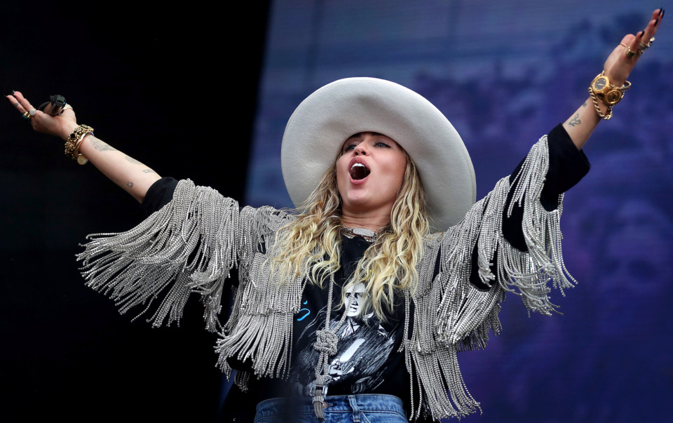 <strong>Pop star Miley Cyrus makes a surprise appearance at the Beale Street Music Festival on May 4, 2019, performing several of her hits as well as a duet with Grammy-winning singer-songwriter Marc Cohn on the Terminix Stage at Tom Lee Park.</strong> (Jim Weber/Daily Memphian)