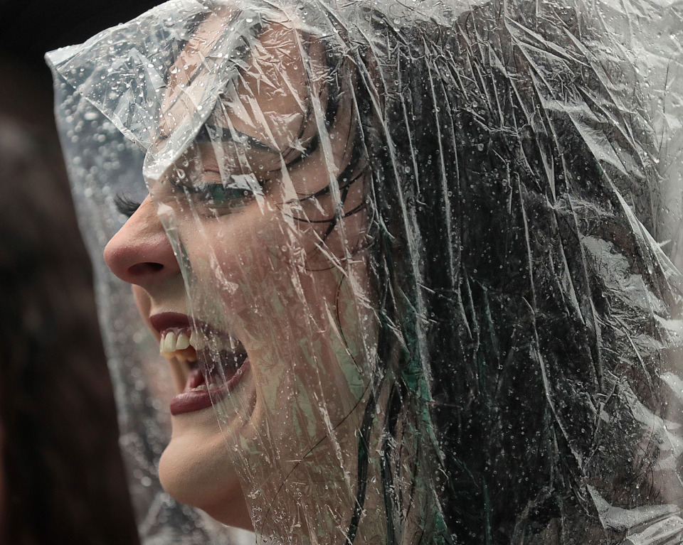 <strong>Kelsey Taylor waits in the rain for the Echosmith show to kick off during the 2019 Beale Street Music Festival on May 4, 2019, at Tom Lee Park. Despite a persistent drizzle, thousands of fans turned out for performances by Muck Sticky, Echosmith, OneRepublic and Blind Mississippi Morris as well as a surprise visit by Miley Cyrus.</strong> (Jim Weber/Daily Memphian)