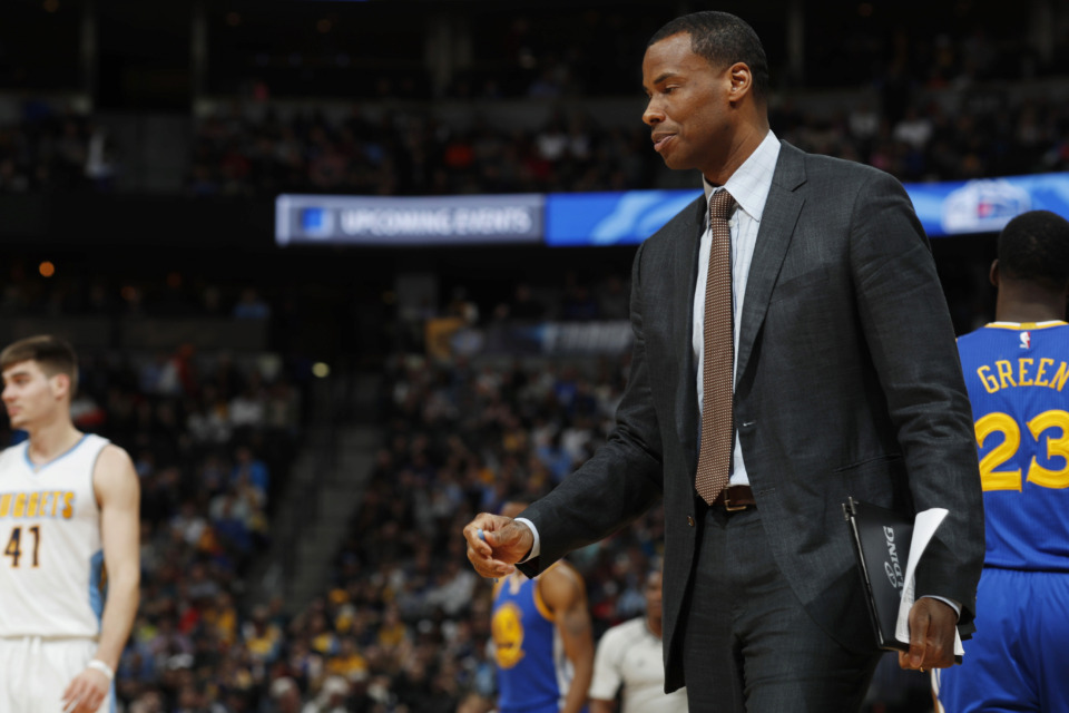 <span><strong>Golden State Warriors assistant coach Jarron Collins in the first half of an NBA basketball game Monday, Feb. 13, 2019, in Denver.</strong> (AP Photo/David Zalubowski)</span>